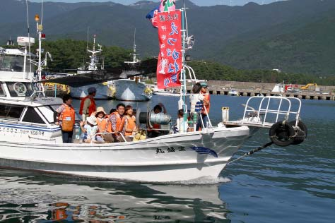 Uchinoura bay fishing boat cruising